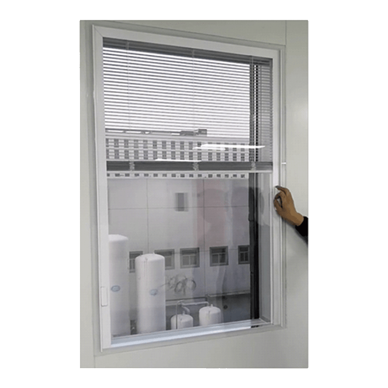 Window with manual magnetic built-in blind